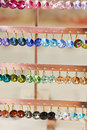 Many earrings in a jewelry store colorful for sale Stock Images
