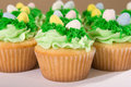 Many Easter Cupcakes with Candy Eggs Stock Photo