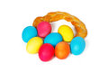 Many easter eggs in a baked pigtail on white background Stock Photography