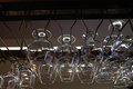 Many empty glasses for a wine hanging in the bar Royalty Free Stock Photo