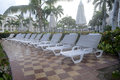 Many empty pool lounge chairs lounger and umbrellas after a rain Royalty Free Stock Photo
