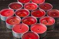 Many extinguished red candles closeup Royalty Free Stock Photo