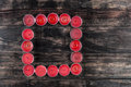 Many extinguished red candles in square shape on wooden table Royalty Free Stock Photo