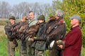 Many Falconers in the hands of golden eagles Royalty Free Stock Photos