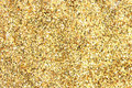 Many festive golden decoration pieces forming background Royalty Free Stock Photography