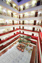 Many floors with balconies and doors to rooms in big modern hotel Royalty Free Stock Images