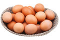 Many fresh chicken eggs in wicker basket isolated on white background Stock Photos