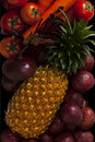 Many fruits fruit in the range pineapple carrot to mato Stock Photos