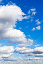 Many furry white clouds in blue sky spring Stock Photos