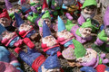 Many garden gnomes a group of small scattered on the ground take a number of different positions some sleeping some lying down and Royalty Free Stock Images