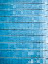 Many glass windows from the high rise building with sky reflection Royalty Free Stock Images
