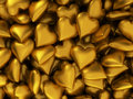 Many golden hearts d background Stock Images