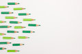 Many green pens forming an arrow to the right with space for copy text Royalty Free Stock Photo