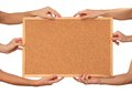 Many hands holding the cork board empty to write your text isolated on white Stock Photo