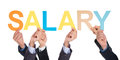 Many hands holding the word salary group of businesspeople over white background Stock Image