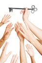 Many hands reaching for key greedy a big Royalty Free Stock Photography