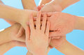 Many hands together over blue sky Royalty Free Stock Photo