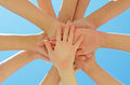 Many hands together over blue sky Royalty Free Stock Photography
