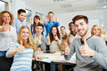 Many happy students teacher holding their thumbs up university Royalty Free Stock Photography