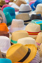 Many hats of all colors for summer a Stock Photos