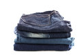 Many jeans stacked isolated on a white background Stock Photography