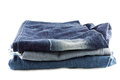 Many jeans stacked isolated on white background a Royalty Free Stock Image