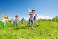 Many kids running and boy holding airplane toy Royalty Free Stock Photo