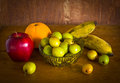 Many kind of fruit still life on old wood table Royalty Free Stock Photos