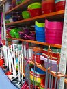 Cleaning and cooking tools on shelf