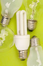 Many light bulbs different on green background Royalty Free Stock Photo