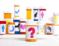 So many medications a medicine bottle with a question mark label in front of other pill bottles background Stock Photos