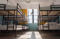 Many metal bunk beds in dorm room for twelve people at youth hostel Royalty Free Stock Photo