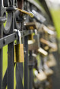 Many metal locks are hanging on black fence Stock Photography