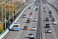 Many modern cars go on bridge at sunny day in moscow russia Royalty Free Stock Photos