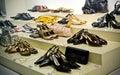 Many modern shoes on shop shelf Stock Photography