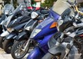 Many mopeds and scooter motorcycles. Royalty Free Stock Photo