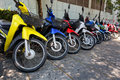Many motorbikes at the parking near big store Royalty Free Stock Photography