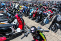 Many motorbikes at the parking near big store Stock Photography