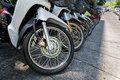 Many motorbikes at the parking near big store Royalty Free Stock Images