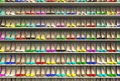 Many multi-colored bright women's high-heeled shoes with a pointed toe stand in a row on the shelves. The wide choice of a Royalty Free Stock Photo