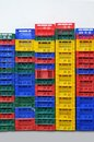 Many multi colored fruit boxes colorful plastic stacked packing containers Royalty Free Stock Photos