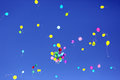 Many multicolored balloons flying in the blue sky Royalty Free Stock Photo