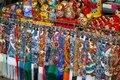 Many multicolored fabric scarves and painted dolls - matryoshkas, so-called Russian souvenirs, lie on the counter in a street stor Royalty Free Stock Photo