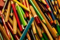 stock image of  Multicolored sharpened coloring pencils on a pile