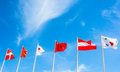 Many national of flag pole on blue sky backgrounds Royalty Free Stock Image