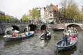 Many people on canal trip in centre of dutch capital amsterdam Royalty Free Stock Photo