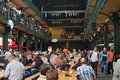 Many people eat lunch on Sunday at the fish market