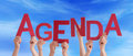 Many People Hands Holding Red Word Agenda Blue Sky Royalty Free Stock Photo