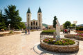 Many pilgrims visit the village church and the nearby Apparition Hill in Medjugorje, Bosnia and Herzegovina Royalty Free Stock Photo