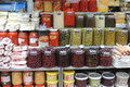 Many pots with different types of olives, peppers and other spices Royalty Free Stock Photo